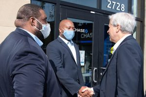JPMorgan Chase President and CEO Jamie Dimon greets Brian Atkins, vice president and ommunity manager, and Jua Williams, branch manager, at the opening of the Chase Banking Center at the Skyland Town Center in southeast D.C. (Courtesy photo)