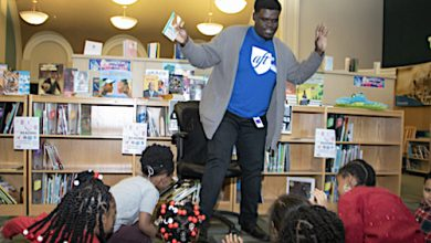 **FILE** Branden Mitchell reads an interactive story to students during library time at Wheatley Education Campus in northeast D.C. (Shevry Lassiter/The Washington Informer)