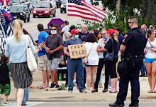 **FILE** A Kyle Rittenhouse supporter in Kenosha Wisconsin standing near Bradford High School hoping to get a glimpse of President Trump's motorcade on Sept. 1, 2020. (Lightburst via Wikimedia Commons)