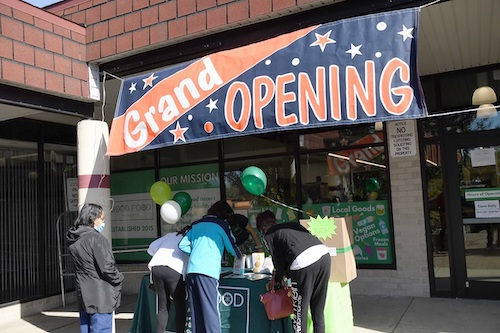 Customers stand outside Good Food Markets and Café in Seat Pleasant during the store's grand opening Oct. 2. (Anthony Tilghman/The Washington Informer)