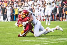 Washington Football Team wide receiver DeAndre Carter is tackled during a 33-22 loss to the New Orleans Saints at FedEx Field in Landover, Md., on Oct. 10. (Abdullah Konte/ The Washington Informer)