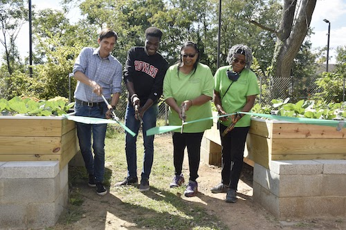 From left: Scott Kratz, vice president of Building Bridges Across the River Engineers Without Borders – USA; Cheikh Badiane, Howard University engineering student; Leslie Haywood; and Velma Speight, director, Allen Chapel AME Church, McKinley Crudum Outreach Center, participate in a Sept. 30 ribbon-cutting ceremony for the Center's newly expanded urban farm. (Robert R. Roberts/ The Washington Informer)