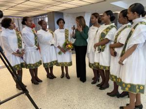 Helen Mesfin, host of the Helen Show on the Ethiopian Broadcast System (EBS) interviews flight attendants at Dulles International Airport celebrating International Women's Day.