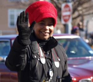 Washington Informer Publisher Denise Rolark Barnes keeps pace while waving at supporters along the Peace Walk/Parade route. (Shantella Y. Sherman/The Washington Informer)