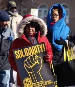 Participants from various social and community organizations near and far made the trek through Anacostia/Congress Heights in frigid temperatures. (Shantella Y. Sherman/The Washington Informer)